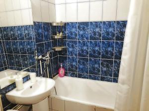 Ванная комната в Apartment Hanaka Federativniy 43