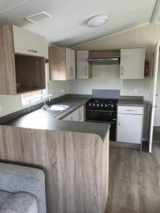 A kitchen or kitchenette at 156 Newquay Bay Resort