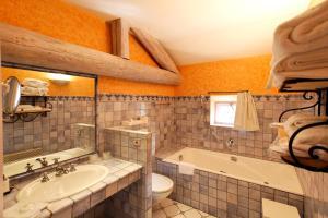 A bathroom at Château d'Adomenil
