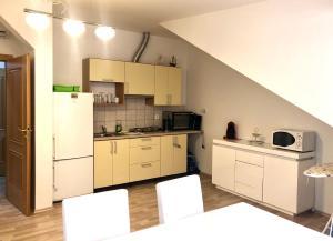 Kuchyň nebo kuchyňský kout v ubytování Apartments Valencia