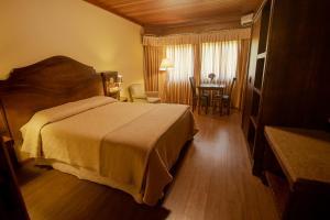 Cama ou camas em um quarto em Pousada Vovó Carolina