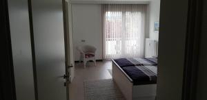 Ein Bett oder Betten in einem Zimmer der Unterkunft Ambiente Ferienapartments Warmbad Villach