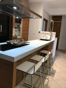 A kitchen or kitchenette at Clean & Comfortable Apartments