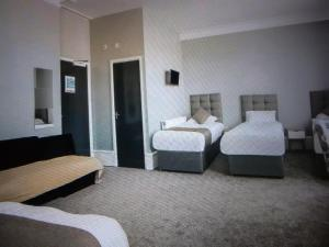 A bed or beds in a room at Newcastle West Hotel & Bar