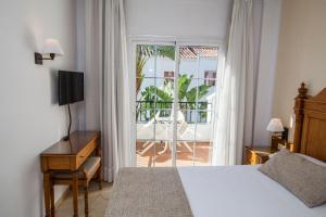 Säng eller sängar i ett rum på Villa Flamenca