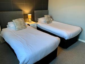A bed or beds in a room at The Fife Arms Hotel