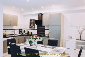 A kitchen or kitchenette at Apartment Winterberg Citylife oder Cityflair free Wifi, PS4, Netflix