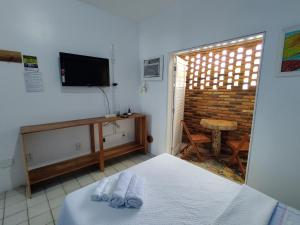 A bed or beds in a room at Pontal dos Sonhos - Suites Enseada Beira Mar