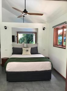 A bed or beds in a room at Forest Views Daintree