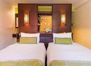 A bed or beds in a room at Vacation Village Phra Nang Inn-SHA Plus