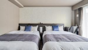 A bed or beds in a room at BON Condominium Namba Ebisu