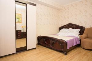 Кровать или кровати в номере Apartments on Yarcevskaya