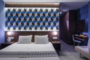 Ein Bett oder Betten in einem Zimmer der Unterkunft Compass beach
