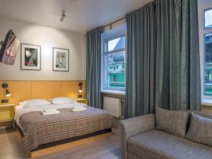 Кровать или кровати в номере Друзья на Фонтанке
