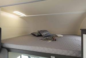 A bed or beds in a room at Rent a Camper
