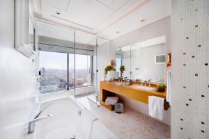 A bathroom at The Domain Bahrain Hotel and Spa