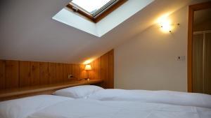 Кровать или кровати в номере Hotel Villa Melì