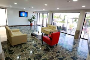 The lobby or reception area at Posada Villa del Carmen