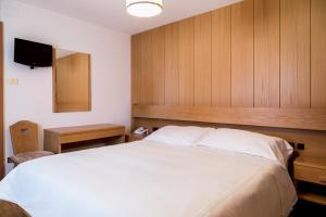 Cama o camas de una habitación en Hotel Miralago