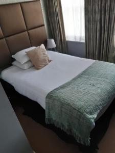 A bed or beds in a room at Cathedral Quarter Hotel
