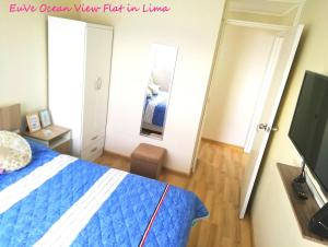 A bed or beds in a room at EuVe Ocean View Flat in Lima