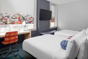 A bed or beds in a room at Aloft El Paso Downtown