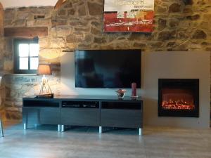 Телевизор и/или развлекательный центр в Clos Du Ry De Snaye