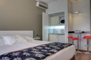 Cama o camas de una habitación en Regency Golf - Hotel Urbano