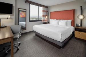 A bed or beds in a room at La Quinta by Wyndham LAX