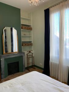 Un ou plusieurs lits dans un hébergement de l'établissement Le Boudoir Tropical