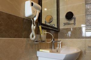 Ванная комната в De'Mar Hotel