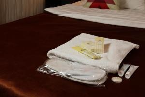 Кровать или кровати в номере De'Mar Hotel