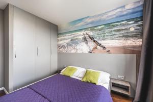 Łóżko lub łóżka w pokoju w obiekcie Apartament Przy Morzu