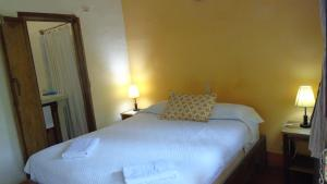A bed or beds in a room at Hotel Casa Barcelona