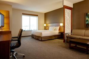 A bed or beds in a room at Hyatt Place Melbourne/Palm Bay