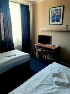 Кровать или кровати в номере Restaurace a penzion Legendario