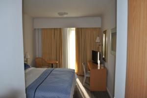 A bed or beds in a room at Chios Chandris