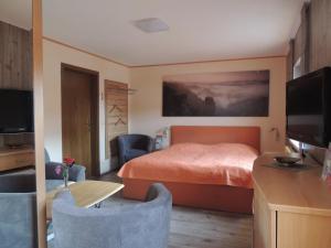 Ein Bett oder Betten in einem Zimmer der Unterkunft Pension 19