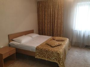 A bed or beds in a room at Dacia Hotel