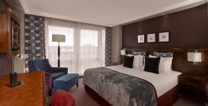 A bed or beds in a room at Crowne Plaza London - Gatwick Airport, an IHG Hotel