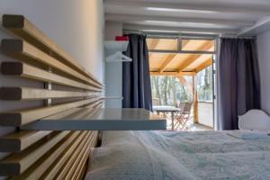 Een bed of bedden in een kamer bij Duinlust Dishoek
