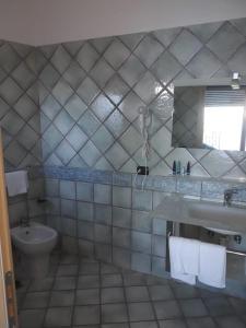 A bathroom at L'Incanto Suites Ischia