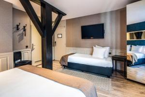 Ein Bett oder Betten in einem Zimmer der Unterkunft Hotel Sint Nicolaas