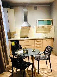 A kitchen or kitchenette at Aparthotel