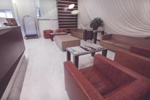 A seating area at Papillo Hotels & Resorts Roma