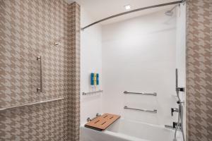 A bathroom at Home2 Suites By Hilton Denver Downtown Convention Center