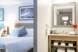 A bed or beds in a room at Snow King Resort