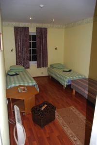 Voodi või voodid majutusasutuse Käbi Külalistemaja toas