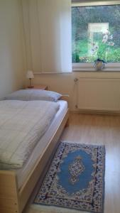 A bed or beds in a room at Haus Papst Johannes Paul. II.