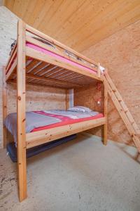 Ein Etagenbett oder Etagenbetten in einem Zimmer der Unterkunft Agriturismo Il Mugnaio Zanetti